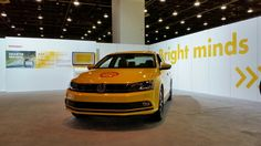 #MakeTheFuture #SEM2015 - The 2015 VW Jetta Hybrid SEL in its base wrap is on display. We'll be giving out Shell Fuel cards to winners of the hourly Q&A contest in the area too. :)