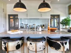 In Love With The Cowhide on these counter height stools!