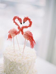 Flamingo topped wedding cake! http://www.stylemepretty.com/new-york-weddings/new-york-city/2016/08/19/minimal-and-modern-nyc-wedding/ Photography: Caroline Yoon - http://www.carolineyoonphotography.com/#0