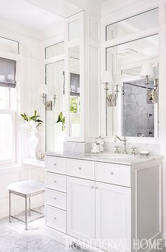 Bathroom. Mirrored panel walls. White cabinetry. Nickel accents. Before and After: Revived Georgian-Style Home   Traditional Home