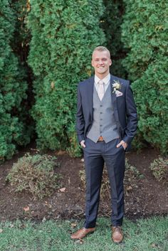 groom in navy and grey wedding suit