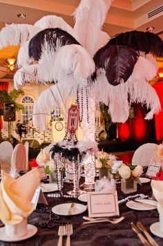 Photo by Morrison Winslow Photography. Ostrich Feather Centerpieces used as part of our lavish tablescapes for our roaring 20's/Gatsby Robert Nardi's 50th Birthday Gala.  Designed  by Steven Bowles of Steven Bowles Creative, Naples, Florida www.stevenbowlescreaive.com