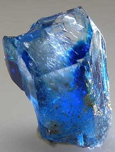 Glassy Euclase crystal with lots of transparent areas. Rich blue color. Though not as gemmy as Columbian Euclase, specimens from this locality have the deepest, most saturated blue color of any Euclase. The mine is long closed and this specimen dates back to at least the 1980s. The front and termination faces are flat and smooth, the backside is a cleavage face. A rarity. AF850 - Euclase $ 400 SOLD Lost Hope Mine, Mwami, Karoi, Zimbabwe