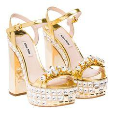 Miu Miu SANDALS    Laminated kid leather platform sandal with jewel ornament, bejeweled platform, and metallic heel.