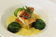 Fillet of cod with braised cabbage and bacon