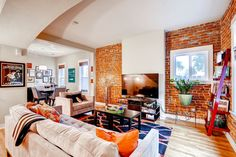 Exposed brick meets modern living in this exquisite home