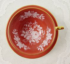 Orange Aynsley Tea Cup and Saucer with White Roses by TheAcreage