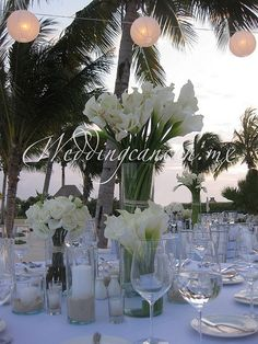i Like this look because it shows a single tall vase & a few lower ones. Beach Wedding Decorations, Wedding Themes, Wedding Centerpieces, Wedding Designs, Wedding Colors, Wedding Styles, Wedding Ideas, Centrepieces, Centerpiece Ideas