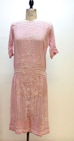 1920,s Antique Art Deco Flapper Pink Cotton Day Dress with White Beaded Flowers. It is made of a slightly sheer pink cotton and white glass beads. Front