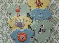 "Welcome to Lovin Oven Cookies!! **PLEASE SEE SHOP ANNOUNCEMENT BEFORE PURCHASING A LISTING OR ORDERING.** If you need your cookies by a specific date, please contact me BEFORE placing an order to ensure I can meet your event date.  This listing is for one dozen (12) BABY ONESIE JUNGLE THEME DECORATED SUGAR COOKIES that measure approximately 4.25"" x 4"". These made from scratch cookies are baked and decorated to order. Cookies are individually wrapped in bakery grade cello bags and heat sealed…"