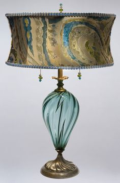 Lucia Table Lamp kn-kinzig-design-lighting-lucia-table-lamp-79s82 This lamp has a vibrant turquoise blown glass, with an oval soft abstract design on dupioni silk, for the shade.