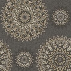 Glitter Medallion wallpaper. This stunning wallpaper features an Aztec inspired geometric pattern, infused with dense sparkling metallic glitter. Shown in Black and Gold.