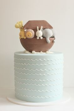Muted, elegant children's cake for birthdays, naming ceremonies, christenings? By the ridiculously talented Hello Naomi.