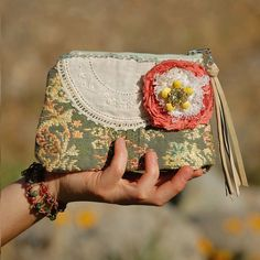 LOVE this clutch! The lace doily, frayed flower, the fabric, everything is perfect <3
