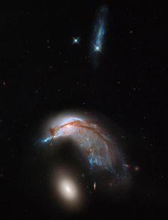 The Nasa/Esa Hubble Heritage Team produced this vivid image of a pair of interacting galaxies known as Arp 142 that bears a striking resemblance to a penguin guarding its egg. Photograph: Hubble Space Telescope Heritage Team/Nasa, Esa
