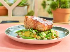 Get Pomegranate-Glazed Salmon with Asparagus-Mint Citrus Salad Recipe from Food Network