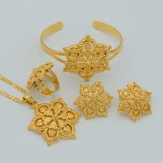 Quality Anniyo Flowers set Jewelry Women Gold Color Pendant Necklace/Earrings/Ring/Bangle African/Arabian/Ethiopian Jewellery with free worldwide shipping on AliExpress Mobile Gold Earrings Designs, Gold Jewellery Design, Necklace Designs, Ring Designs, Star Jewelry, Rose Gold Jewelry, Quartz Jewelry, Copper Jewelry, Ethiopian Jewelry