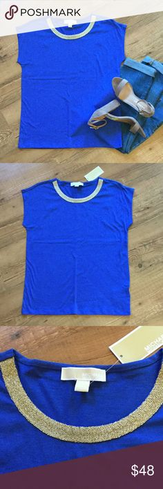 "Michael Kors blue top with gold trimmed neckline Blue short sleeve top with gold trimmed neckline. 60% cotton, 40% modal. Bust (laying flat) 18 1/2"". Length 24"".  Please ask any necessary questions prior to purchasing. No trades. Save even more with a bundle discount! MICHAEL Michael Kors Tops Tees - Short Sleeve"