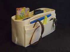 Oatmeal Felt organizer Made to Order Keep your Purse organized and Clean with the Original Felt Bag Organizer Felt insert fits in any small bag that measure about 12 wide (side to side) 6 tall or taller and 3 deep. Size 12 wide (side to side) 6 tall 3 deep Insert has four pockets on outside front. One back pocket on outside 12 by 5. One 2 slot removable divider inside. 2 Pockets on inside. Total of 8 pockets. Plus large open center space. Hard Sturdy bottom No sagging bottoms when you ch...