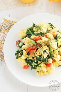 Kale, Egg and Cheese Scramble - an easy breakfast with fresh kale, red pepper, onions and cheese. Start the day with a hearty meal packed with protein and vitamins!