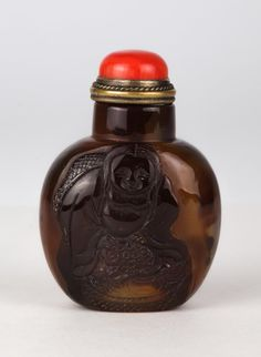 Chinese Agate Snuff Bottle, One Side Carved in Relief of Liu Hai, Coral Stopper