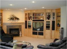 This entertainment center was custom designed to wrap along this angled wall. There are five spaces for home theater speakers with mesh speaker cloth doors. Wood Interior Design, Wood Design, Custom Fireplace, Tv Fireplace, Entertainment Center Wall Unit, Budget Book, Health Pictures, Bakery Design, Signage Design