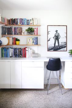 Make a long, built-in style desk by hanging cabinets and creating your own custom countertop— click through for pictures & instrucitons.