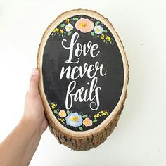 """Wood slice painting """"love never fails"""" by @theolivetreedesigns  Hand painted with acrylic paint and sealed with protector to ensure long lasting beauty.  Love the florals! This shop designs beautiful instant downloadable Christian printables, jewelry, and mugs. Very inspiring shop. Love everything!  theolivetreedesigns.etsy.com"""