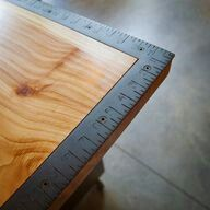Craft room table top with attached metal yard sticks. Fill center with pictures and memorabilia and fill with epoxy.
