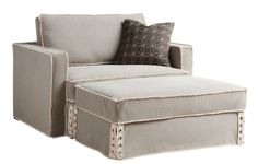 The Texas-sized Epicenters Austin - Nelson Ottoman is slipcovered in canvas with distressed seams and sturdy lacing at the front corners. #austincollection #arthomefurnishings #canvasottoman #canvasfurniture #distressedottoman #slipcoverfurniture