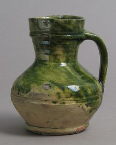 JugDate: 15th–16th century Geography: Made in Surrey, England Culture: British Medium: Earthenware, glazed Dimensions: Overall: 4 1/2 x 3 3/4 x 3 5/8 in. (11.5 x 9.6 x 9.2 cm)