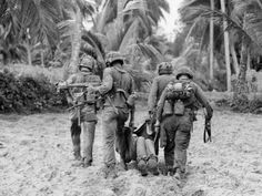 Vietnam War US Casualty Photographic Print by Henri Huet at AllPosters.com