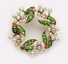 Edwardian Demantoid garnet, natural pearl, diamond and gold wreath brooch.