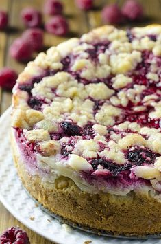 Raspberry Cream Cheese Coffee Cake - All the flavors you love...moist and buttery cake, creamy cheesecake filling, juicy raspberries and a crunchy streusel topping!!