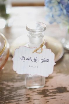These vintage bottle seating cards make great gifts for the guests to take home! #wedding #favors