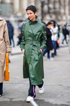 Yasmin Sewell wears a green trench coat during Paris Fashion Week Womenswear Fall/Winter 2018/2019 on March 1 2018 in Paris France