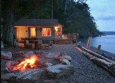 Tiny Beach House On The Water ❤ on Orcas Island, near Washington state is for rent. Love the bonfire and warm glow. | Tiny Homes