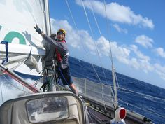 This is me, captain Greg, showing three fingers indicating a triple reef in the main sail and still cooking along. This day was gorgeous, but the night came and in blew a depression and we got caught in our second gale (four days out from St John's NL) This was the scariest time of our journey. Waves in the 20-30 ft range and wind gusts over 50kts. Normally that might be ok but it lasted 36 hours. We were tired, really tired. Notice my sailing helmet.