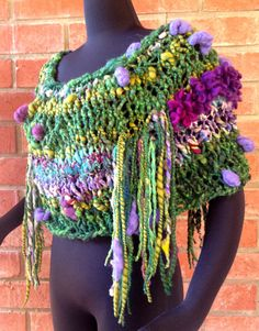 Delicious FUN worked up in this fringed Cowl/Shoulder-warmer! It gets a textural kick from 4 of UNIQUE Hand-Spun Art Yarns. By CharMedFibers