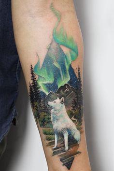 Wolf tattoo by Deborah Genchi - Get inspired with the Tattoodo App! - #wolftattoo #foresttattoo #landscapetattoo #naturetattoo #realismtattoo #colortattoo #uniquetattoo #animaltattoo #auroraborealis #beautifultattoo #tattooidea #tattooinspo #tattooinsperation #tattoodesign