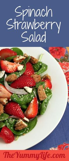Spinach Strawberry Salad with Candied Pecans, Feta, & Raspberry Poppyseed Dressing. Beautiful, refreshing, and delicious!  from The Yummy Life