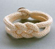 French knitted Wool Bracelet - Inspiration only. No pattern. Yes, it's knitted--not crocheted--but I must try to duplicate in crochet. Finished product for sale on Etsy.