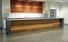 Kitchen island bench- formed polished concrete top (or stone) and timber front to match cupboards