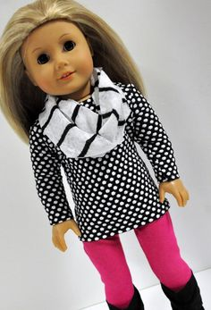 This listing is for a black and white polka dot tunic style knit top. It has long length sleeves. The back closes in the back with Velcro. The