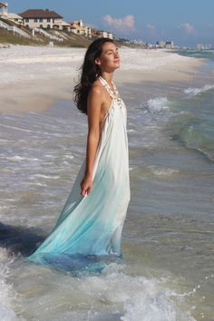 Why you love itFor the ultimate showstopping stunner, look no further than the Maldives gown.  Reminicent of a mermaid that tumbled out of the ocean, this gown is constructed from hand-painted ombre silk in a myriad of blues and greens.  Hundreds of hand-sewn iridecent beads cover the yoke which transforms into a twisted halter back.  Pleating around the entire gown and a small train complete this compelling look.Style itThis is a stand-alone dress--a truly a one-of-a-kind statement piece.