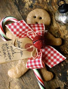 Homemade gingerman and vintage gift tag with candycane