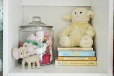 Store extra bows and headbands in a jar on a shelf - looks adorable! #nursery