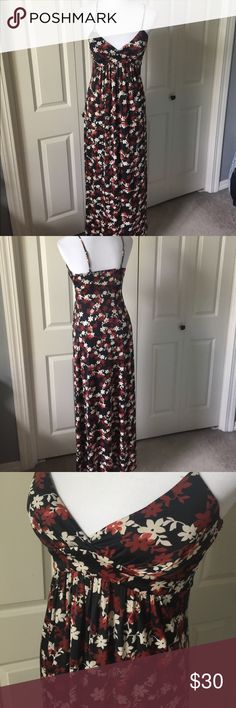 Black and brown floral maxi dress Adjustable shoulder strap's. Lightly padded cups. 92 1/2% polyester 7 1/2% spandex. KR SD II Dresses Maxi