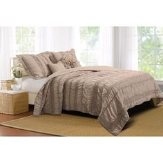 Elegant and sophisticated, this romantic bedding set combines both ruffles and ruching. Oversized for better coverage on today's deeper mattresses. The quilt set features a silky microfiber face and back and includes two comfortable bonus pillows.