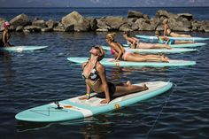 this is my DREAM day. yoga on a paddle board. sign me up !!!!
